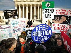 Demonstrators argue over abortion in front of the Supreme Court in January.