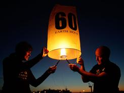 Countdown: Lanterns are released over Sydney. On Saturday, everyone is asked to switch off lights for an hour at 8:30 p.m. for Earth Hour.