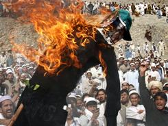 A crowd in Afghanistan burns an effigy of Florida pastor Terry Jones on Monday in Shinwar, east of Kabul.