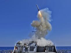 Off the Libyan coast: The destroyer USS Barry launches a Tomahawk cruise missile last month.