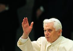 Pope Benedict XVI offers a blessing during his weekly general audience at the Vatican.