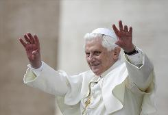 Pope Benedict XVI waves to the faithful as he leads a weekly audience in Saint Peter's Square at the Vatican in October 2009. The pope is easing celibacy rules for Anglican priests who convert, which experts say will exacerbate the issue among Catholics.