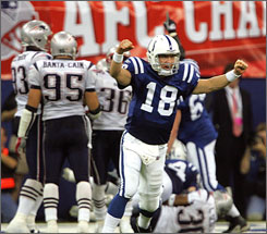"Peyton Manning celebrates after the Colts clinched a spot in Super Bowl XLI. The Indianapolis quarterback said he felt no personal vindication after the win. ""I didn't get any monkeys off my back,"" he said. ""I don't play that card. I know how hard I worked this season, how hard I worked this week."""