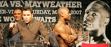 While Oscar De La Hoya speaks at the podium Wednesday in Washington, Floyd Mayweather Jr. does a little upstaging. The super welterweight fighters are making an 11-city media tour promoting their May 5 title bout at the MGM Grand in Las Vegas.