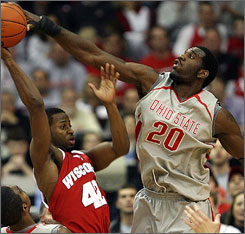 Ohio State's Greg Oden, here blocking a shot by Wisconsin's Alando Tucker, says he won't decide on the NBA until after Ohio State's season comes to and end.