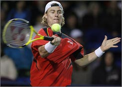 Lleyton Hewitt rares back for a return to Marat Safin in their semifinal match.