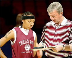 Texas A&M guard Takia Starks looks at coach Gary Blair's diagram of a play during practice for the Big 12 tournament in Oklahoma City. Blair says recruiting in-state has helped the program.