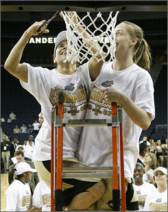 Vanderbilt's Jennifer Risper, left, and teammate Christina Wirth cut down a portion of the net after defeating LSU in the SEC championship.