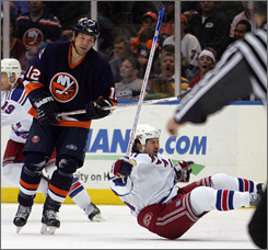 The Rangers' Ryan Hollweg hits the ice hard after being clotheslined by Chris Simon's stick during the third period.