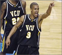 "Eric Maynor points to VCU fans in the stands after his jumper with just 1.8 seconds left propelled the Rams to a 79-77 upset of Duke in the first round. ""Everything is different now,"" Maynor says. ""That shot, that's how people know me now. It's crazy. But it feels great."""