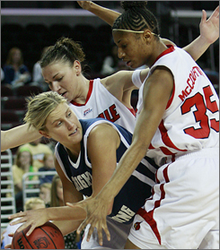 BYU's Melinda Johnsen is trapped by Louisville's Angel McCoughtry, right, and Yuliya Tokova during the first half of the Cardinals' rout.