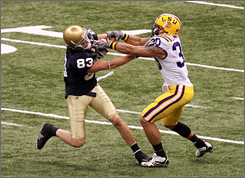 LaRon Landry, shown during the Sugar Bowl defending Notre Dame's Jeff Samardzija, improved his draft stock from second-round material to a likely first-round pick after returning to LSU for his senior season.