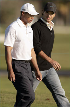 Tiger Woods, left, and Roger Federer walk together during a practice round at the Doral Resort and Spa Blue Course in Miami.