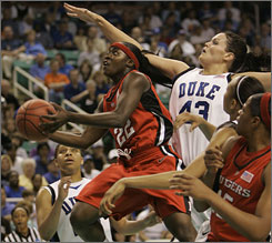 Rutgers' Matee Ajavon goes to the hoop against Duke's Alison Bales in the first half.