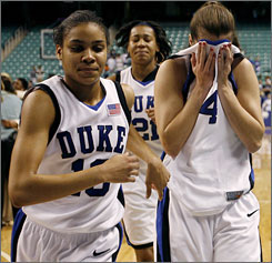 Lindsey Harding, left, and her Duke teammates leave the court following their stunning loss to Rutgers.