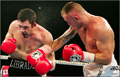 Mikkel Kessler, right, lands a punch on challenger Librado Andrade. Kessler defended his WBC and WBA belts.