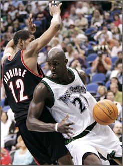 Minnesota's Kevin Garnett, shown driving on Portland rookie LaMarcus Aldridge, is the NBA's highest-paid player.