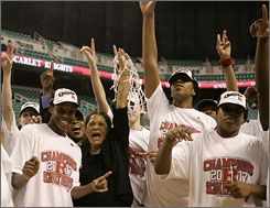Rutgers coach C. Vivian Stringer celebrates with players after securing the school's second trip to the Final Four.