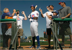 New center fielder Alfonso Soriano is the centerpiece of a $300 million attempt to make the Cubs contenders again.