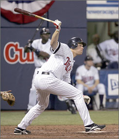Reigning AL MVP Justin Morneau singles during the key three-run fifth inning that carried the Twins to a 7-4 win over the Orioles on opening night at the Metrodome. Morneau's hit helped Cy Young winner Johan Santana to the victory.