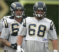 Chargers guard Kris Dielman, right, cited chemistry with Nick Hardwick, left, and the rest of the offensive line among the reasons he stayed in San Diego for a six-year, $39 million deal, rejecting an offer from the Seahawks that was $9 million higher.