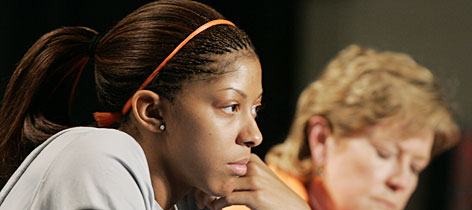 Sophomore swingman Candace Parker, left, ponders a question as Tennessee coach Pat Summitt listens during a news conference Monday in Cleveland.
