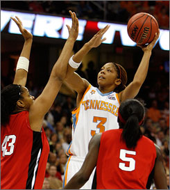 Tennessee's Candace Parker goes up for a shot over Rutgers' Rashidat Junaid and Essence Carson during the title game. Parker tallied 17 points as the Lady Vols claimed their first title since 1998.