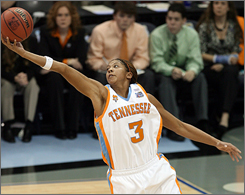 Candace Parker hauls in a rebound in the first half of the national title game. Tennessee dominated the boards, outrebounding Rutgers 40-30 in their 59-46 victory.