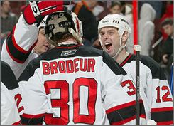 Jim Dowd has a big smile for Martin Brodeur after the Devils goaltender set the NHL record for victories in a season.