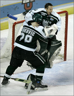 Michigan State goalie Jeff Lerg, right, celebrates with teammate Daniel Vukovic after winning the Spartans' third NCAA hockey championship.