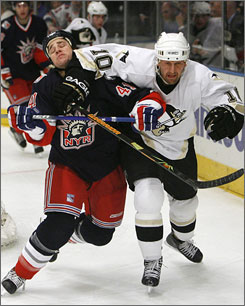 Gary Roberts, right, elbowing Jed Ortmeyer, was a hot commodity at the trading deadline for teams looking ahead to the postseason. Pittsburgh landed the 6-2, 209-pound winger from the Florida Panthers.