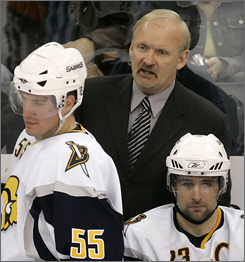 Buffalo coach Lindy Ruff, back, hopes to guide the top-seeded Sabres to their first-ever Stanley Cup.