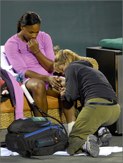Serena Williams receives medical attention during her second-round match with Chan Yung-Jan.