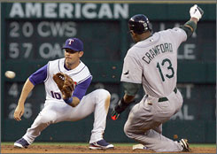 The Texas Rangers - with shortstop Michael Young taking the throw from catcher Gerald Laird - cut down Tampa Bay's Carl Crawford tyring to steal on Tuesday. Crawford was nabbed one other time, meaning he was caught stealing twice in one game for the first time in his career. He had one stolen base in one try in Wednesday's Devil Rays victory at Texas.