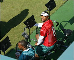 Daunte Culpepper did not participate in drills as the Dolphins, with new linebacker Joey Porter in tow, opened their first minicamp under rookie coach Cam Cameron.
