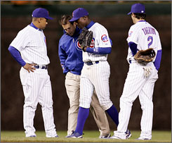 Cubs center fielder Alfonso Soriano, center, pulled a hamstring while attempting a diving catch in the fifth inning of the Cubs' 12-4 win over San Diego. Soriano signed an eight-year, $136 million contract in the offseason.
