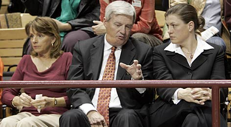 Virginia Tech football coach Frank Beamer talks to women's basketball coach Beth Dunkenberger as he and his wife, Cheryl, await the start of a memorial ceremony in Blacksburg, Va.