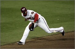 Washington second baseman Felipe Lopez fields a ground ball while donning a Virginia Tech hat.