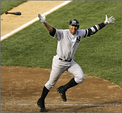 Alex Rodriguez tosses his bat aside after belting a three-run, walk-off homer to help the Yankees down the Indians 8-6 in New York. The blast was Rodriguez's 10th of the season.