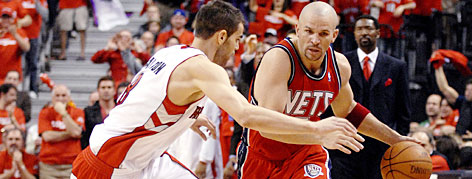 Jason Kidd works his way around Raptors defender Jose Caleron during Game 1 action Saturday in Toronto. It was a typical game for the Nets veteran, who fell two points shy of a triple-double while finishing with 15 dimes and 10 boards.