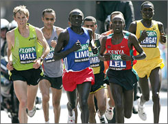 Martin Lel of Kenya, second from the right, sets the pace on the way to a London Marathon triumph. American distance runner Ryan Hall, left, impressed with a seventh-place effort.