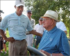Many players came to play at the Byron Nelson Classic out of respect for the late golfer. Tiger Woods chats with the legend in this 2005 photo.
