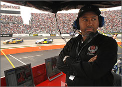 Max Siegel, president of global operations for Dale Earnhardt Inc., keeps watch over the proceedings at Martinsville Speedway.