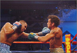 Juan Diaz lands a shot to Acelino Freitas during the seventh round of the WBA-WBO title bout. Diaz wants to try and unify the belts, hoping to get title shots for the WBC and IBF crowns as well.