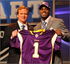 New Minnesota running back Adrian Peterson, shown with commissioner Roger Goodell after the Vikings selected him at No. 7, says his collarbone is 90% healed from last season's injury while at Oklahoma.