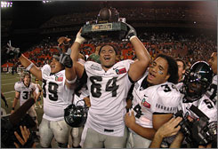 Samson Satele, center, and Reagan Mauia (34) are two of five Hawaii players selected in this weekend's NFL draft.