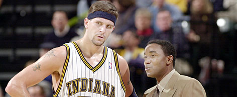Of the seven previous offseason coaching hires in Indiana's NBA history, five resulted in better records. One that didn't: when Isiah Thomas, shown with former Pacers center Brad Miller, replaced Larry Bird before the 2000-01 campaign.