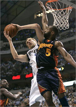 The Mavericks' Dirk Nowitzki, left, and the Warriors' Baron Davis are the leaders of their respective teams. Both need to perform at the end of games for their squads to enjoy success.