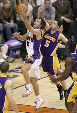 Phoenix's Steve Nash tries to lay the ball in as Los Angeles' Jordan Farmar trails behind. Nash and the Suns now face the Spurs in the Western Conference semifinals.
