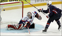 The United States'   David Backes scores a goal on Slovakia goalie Karol Krizan during Thursday's game. The U.S. defeated Slovakia 4-2.